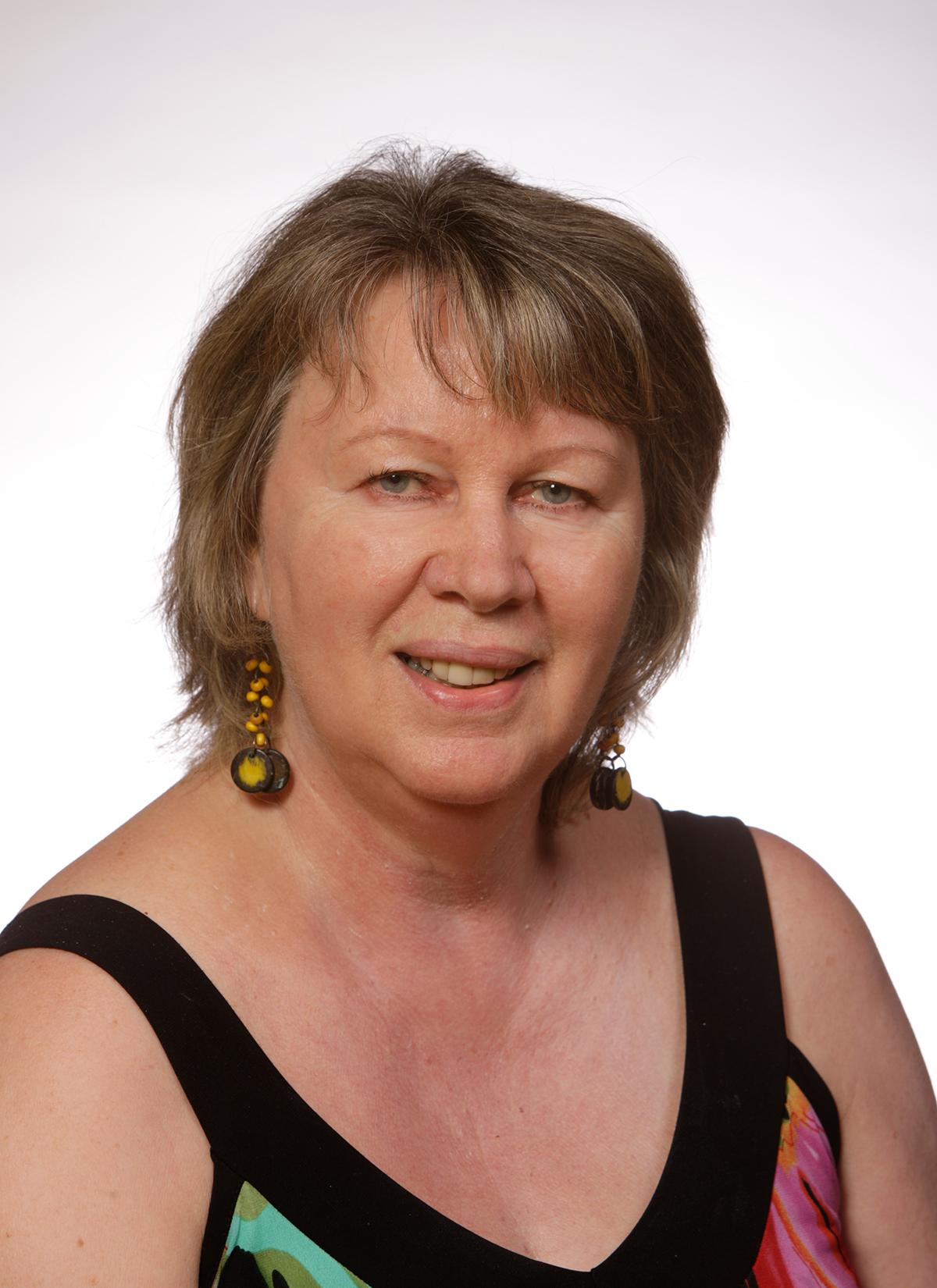 Mme Denise Girard