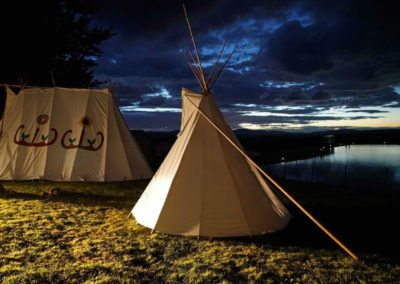 Amerindian tents after dark